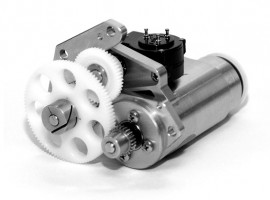 Electric motor assembly - sliver motor with white gears.