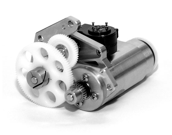 silver electric motor assembly with white gears