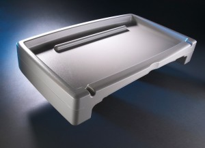 A twin sheet thermoformed tray with walls to prevent spilling.